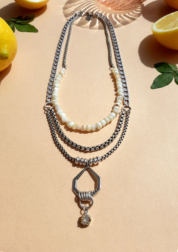 Three layered silver Shelly Dahari necklace with drop charm and shell beads