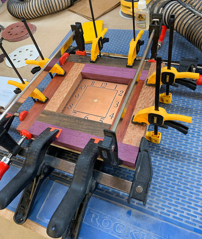 Red Log Cabin Clock Under Production