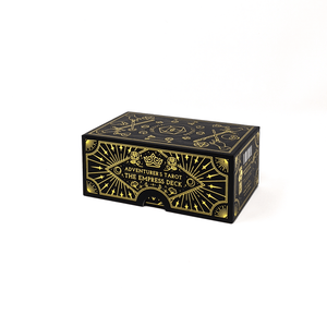 Adventurer's Tarot box side: small black box with intricate, shiny gold decorations and lettering