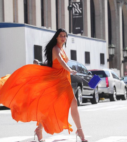 Oange maxi dress worn by Shani Amit at New York Fashion Week, dress by Pink Tree Label