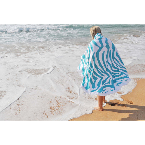 ocean and model with tribal beach towel