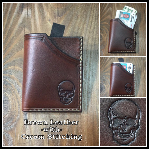 Handmade full grain leather front pocket minimalist wallet with skull stamped on it.
