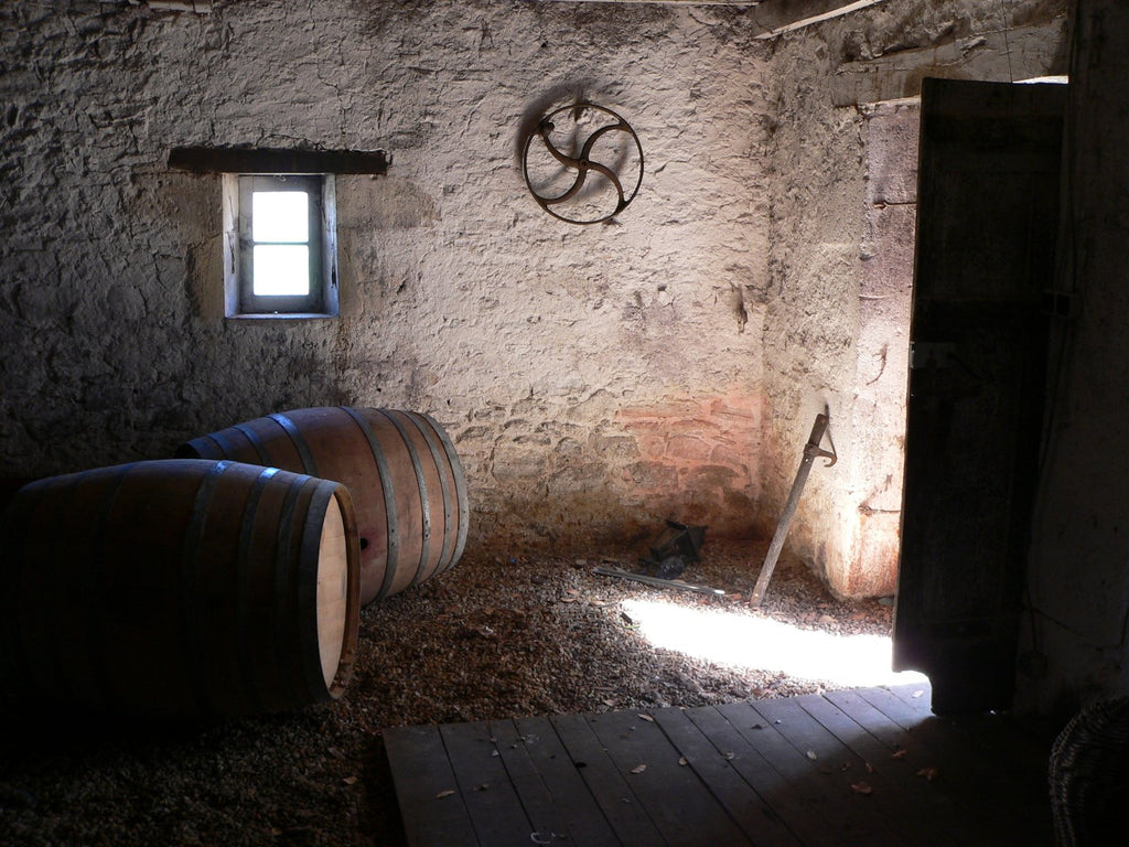 A view of an old barrel room in a French winery in Burgundy.