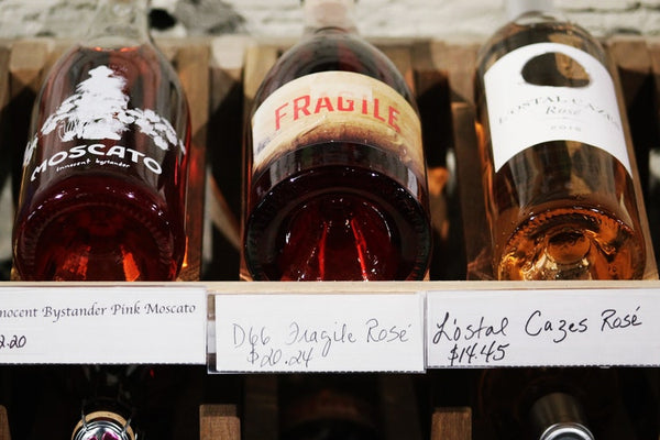 A typical selection of rose wine in a shop.