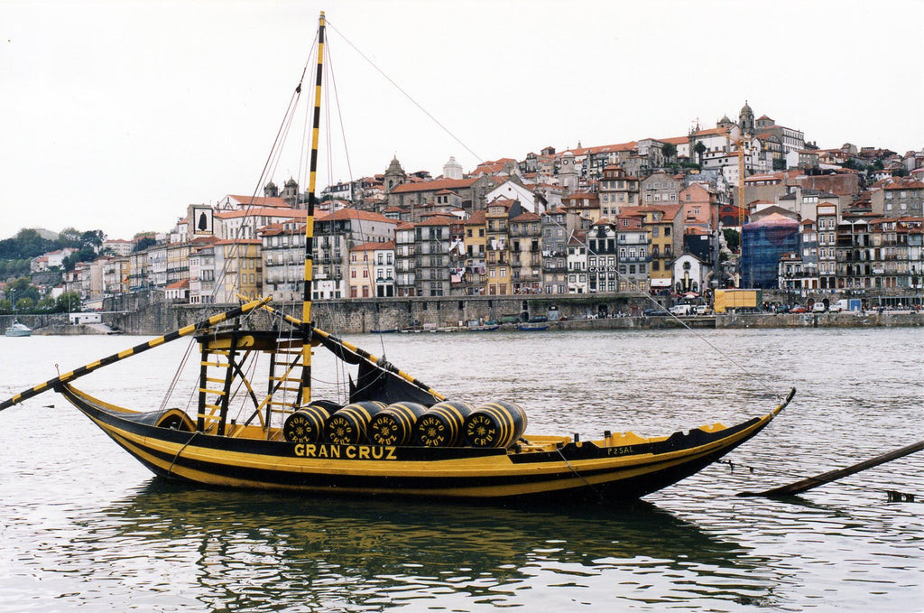 An old boat in Porto, Portugal, shipping barrels of Port wine down the river