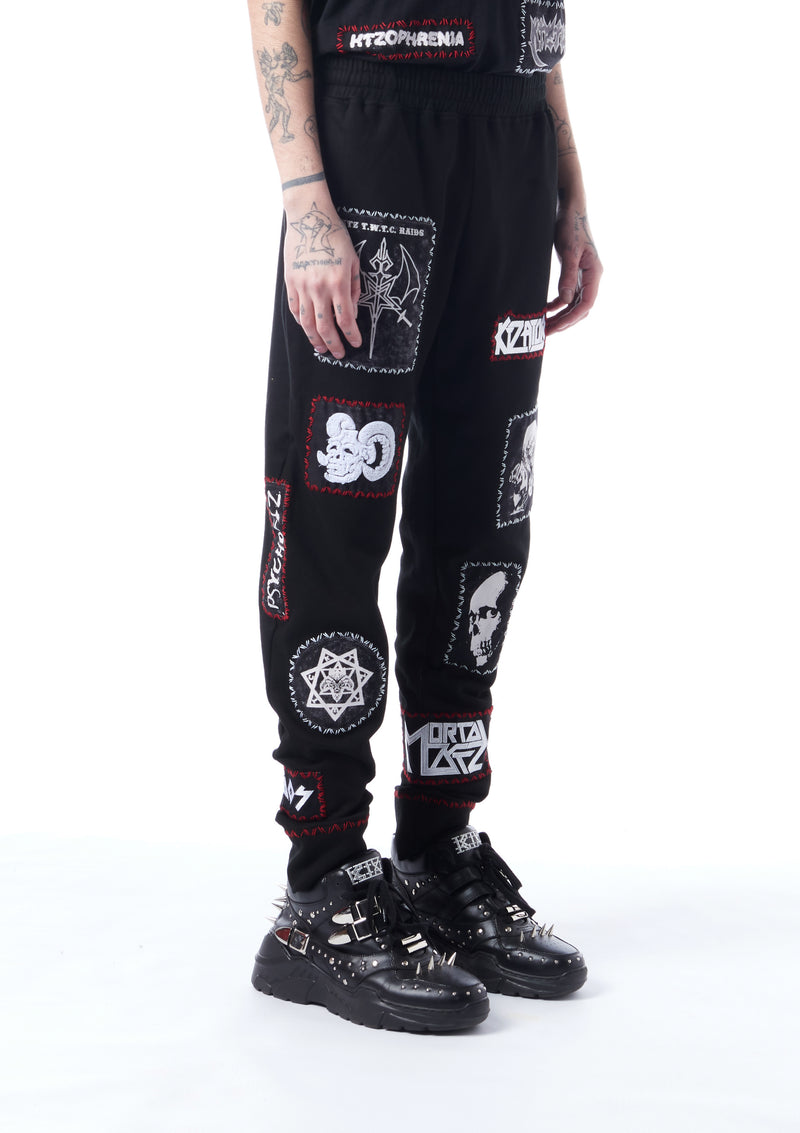 patch-detailed track pants