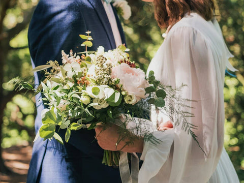 Bride and groom holding bouquet flower