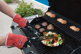 action shot of a grill cook using the gloves to cook, the bottle opener is out of the way, making the gloves easy to use