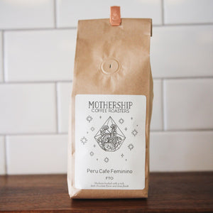 12oz bag of Mothership roasted Peru Cafe Femenino coffee beans
