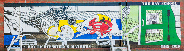 """a photo of the mural on the side of the Bay School building, titled """"Roy Lichtenstein's Mathews""""."""