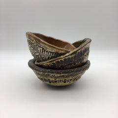 three highly textured brown ceramic bowls