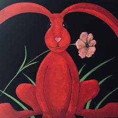 A bright painting of a funky red rabbit with a flower in its mouth, on a black background, by artist J Lyn Henderson
