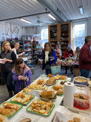 Guests get their soup, bread, and cookies in the Bay School's pottery studio