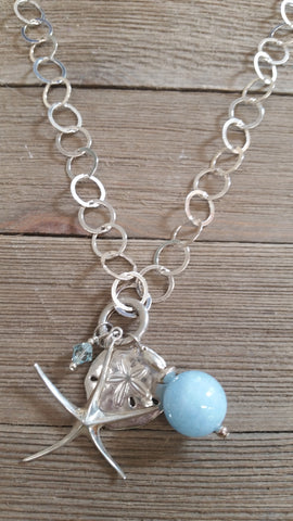 Jim and Linda Harrison- Sterling Silver Starfish and Aquamarine Necklace