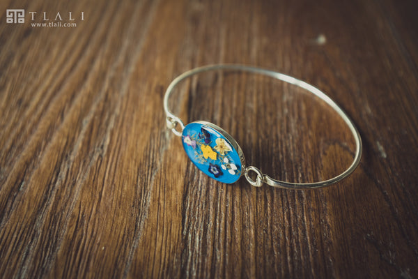 Spring Bloom: Multi-Flower Oval Bracelet