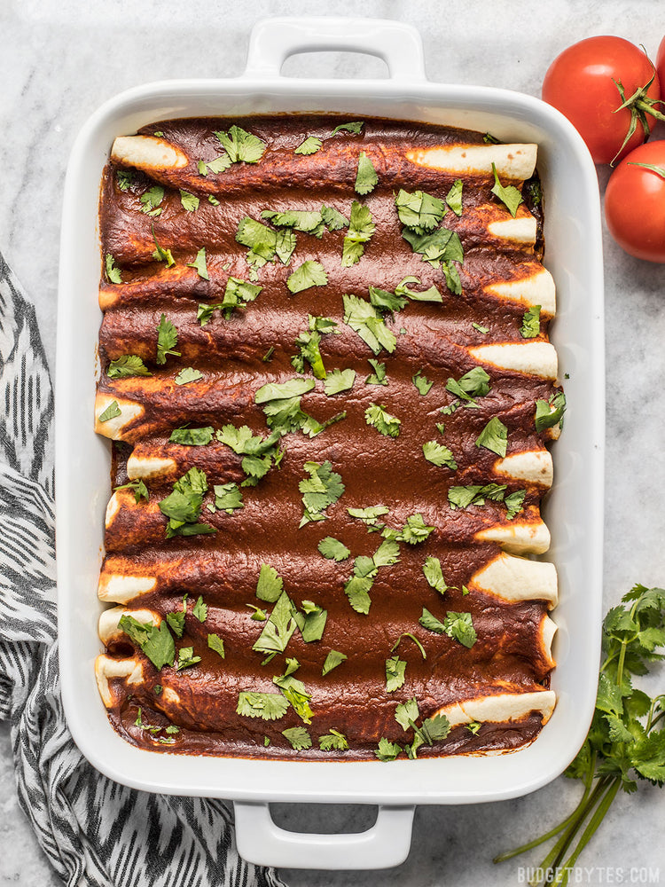 Load image into Gallery viewer, black bean and avocado enchiladas