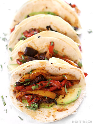 Load image into Gallery viewer, line up of four Chipotle Portobello Oven Fajitas, facing front