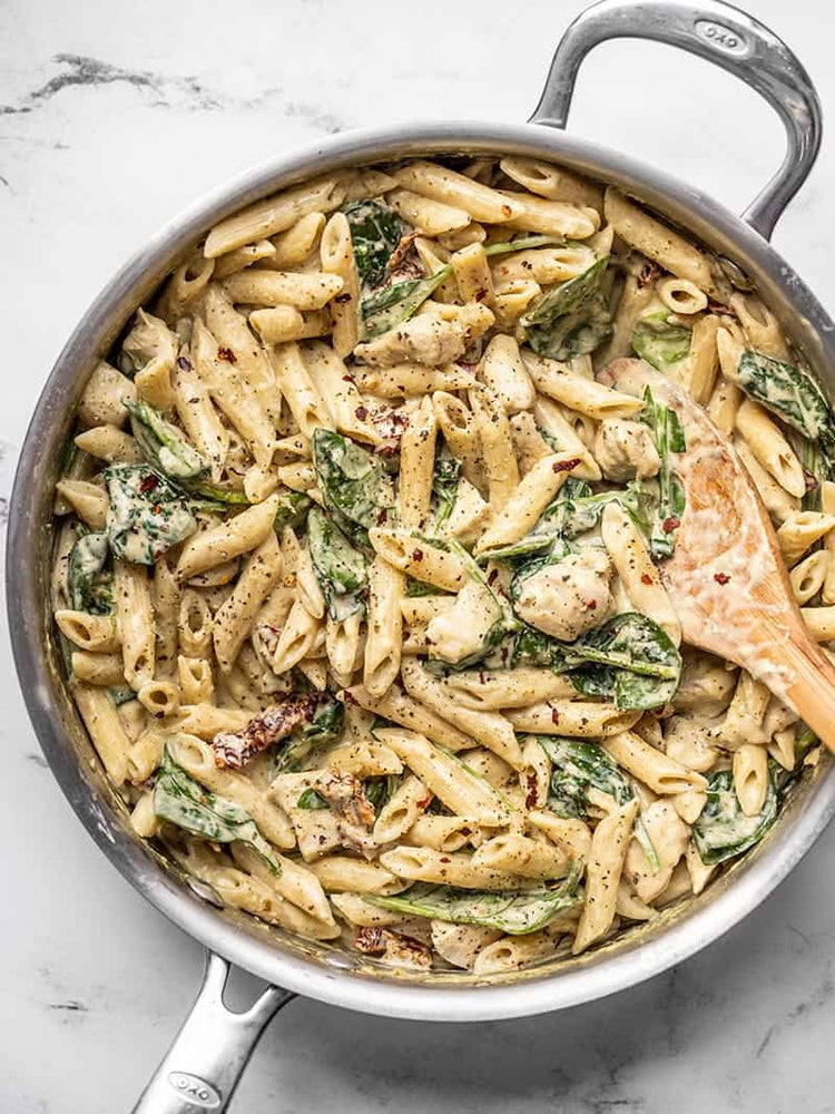 Load image into Gallery viewer, creamy pesto chicken pasta in the skillet