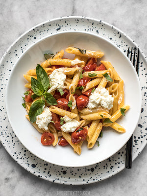 Load image into Gallery viewer, A bowl of Fresh tomato basil pasta with ricotta, garnished with fresh basil