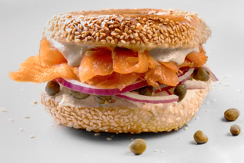 Lox and Cream Cheese Sandwich: Slices of smoked salmon, cream cheese, capers, red onions and lemon caper Aioli