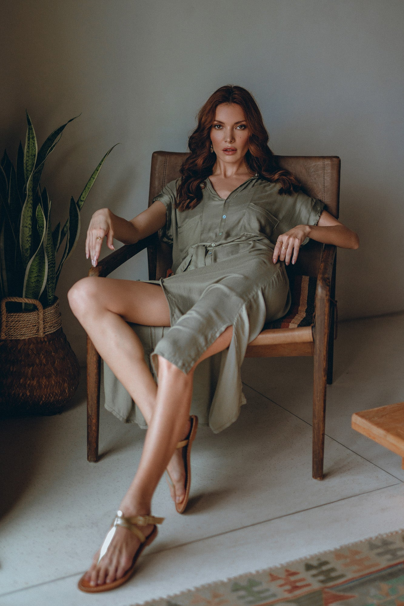 model looking straight into the camera dressed in an olive classic shirt dress