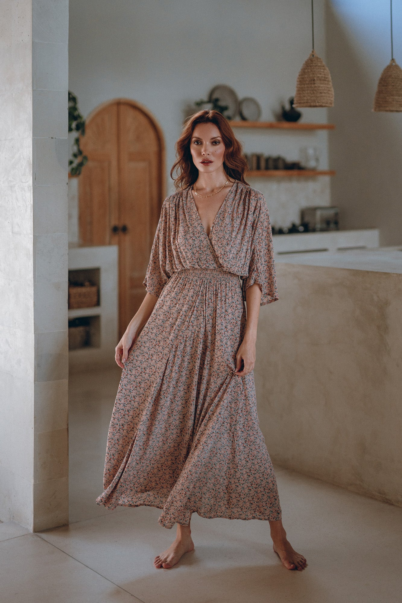 woman in a botanical maxi dress in a house near riviera resort