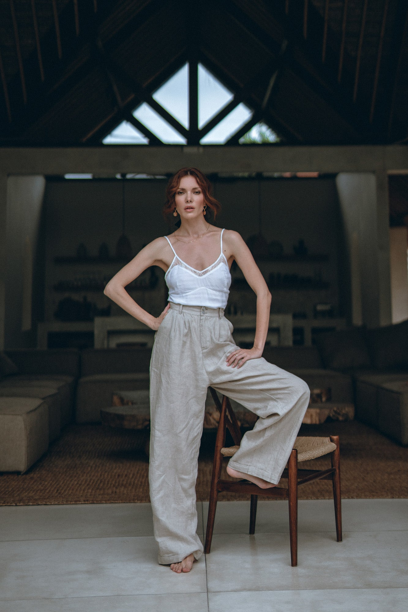 model presenting comfortable linen pants in a resort house