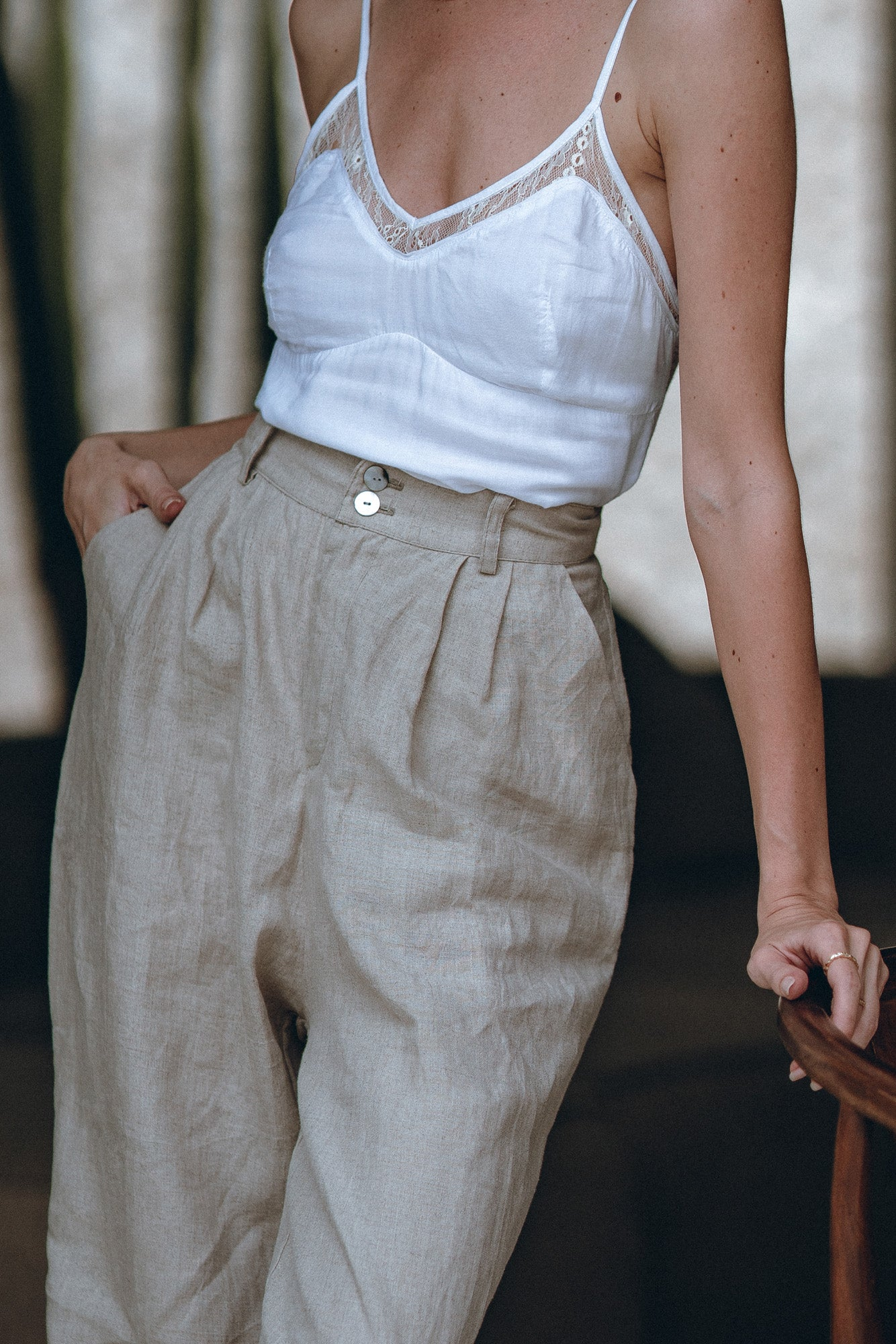 detail shot on a woman wearing natural comfy pants made of linen with pockets