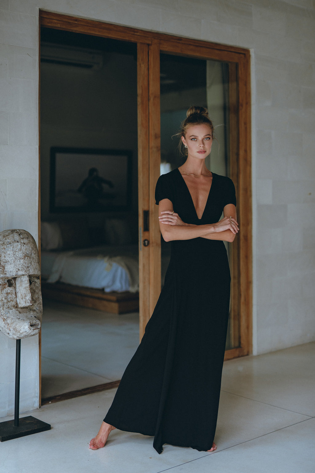 image of a model in a black maxi dress on her holiday getaway