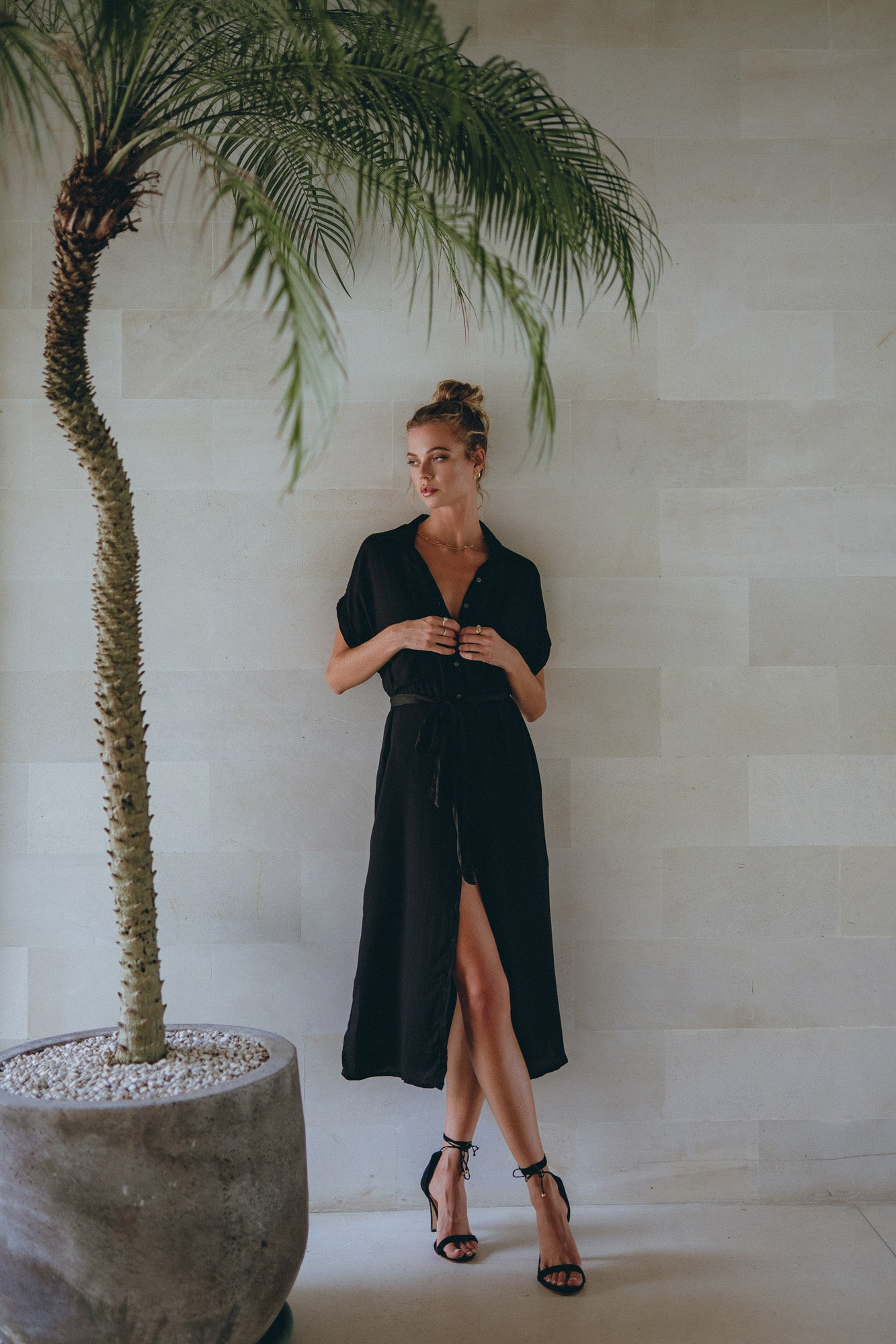 model in black shoes and matching classic shirt dress