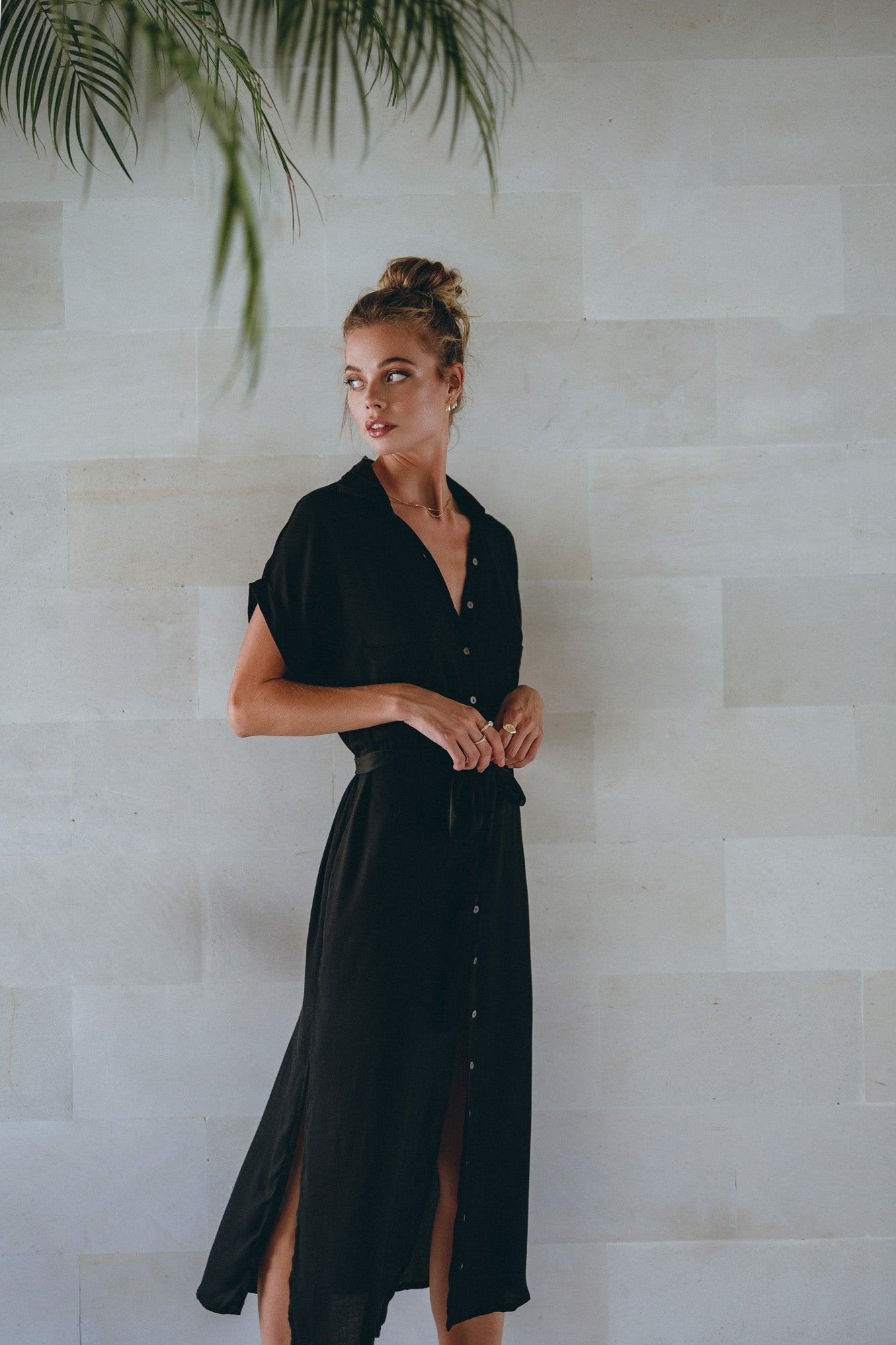 model presenting a classic black midi dress