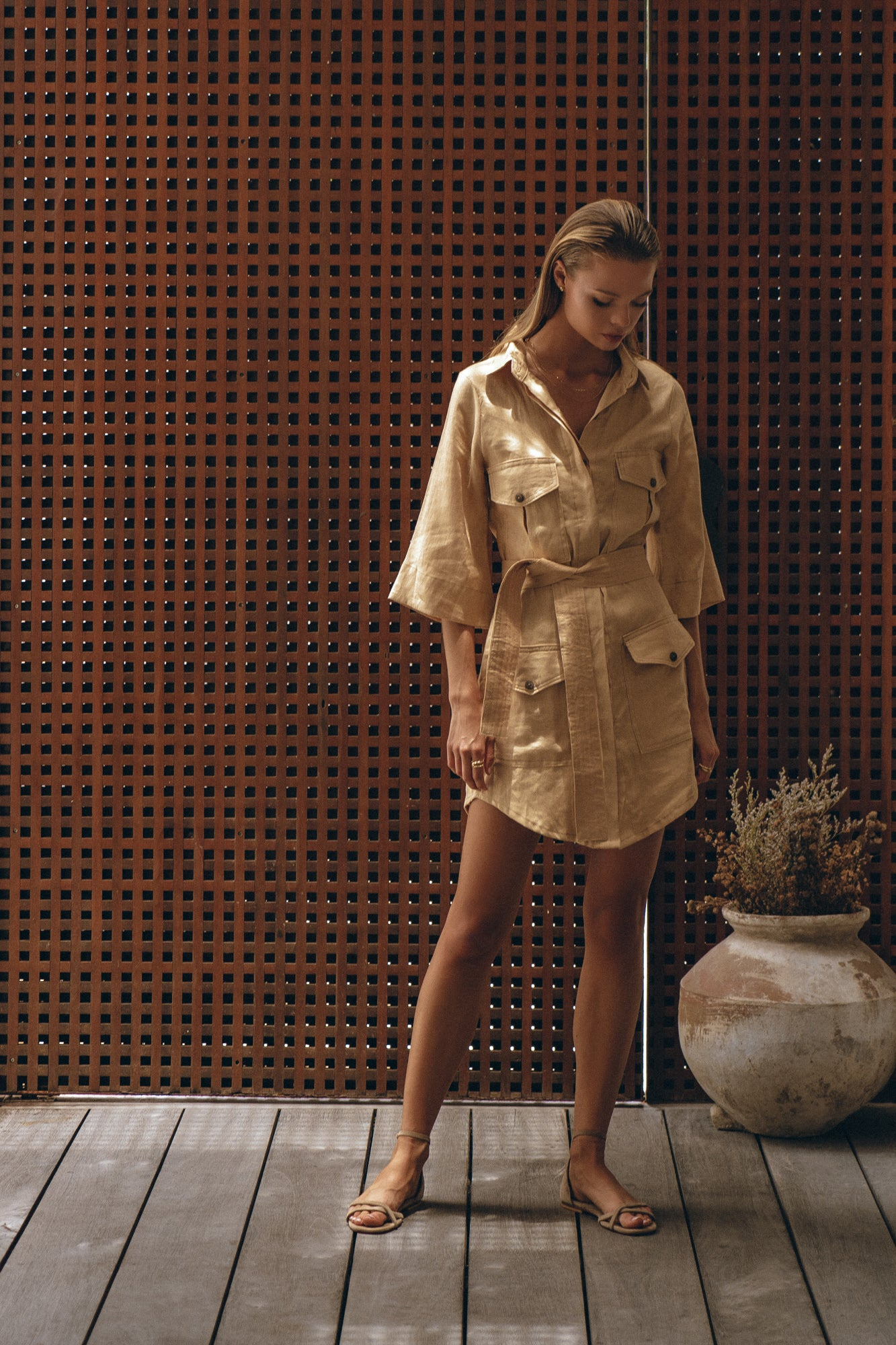 classy linen shirt dress presented on a female model in a French resort