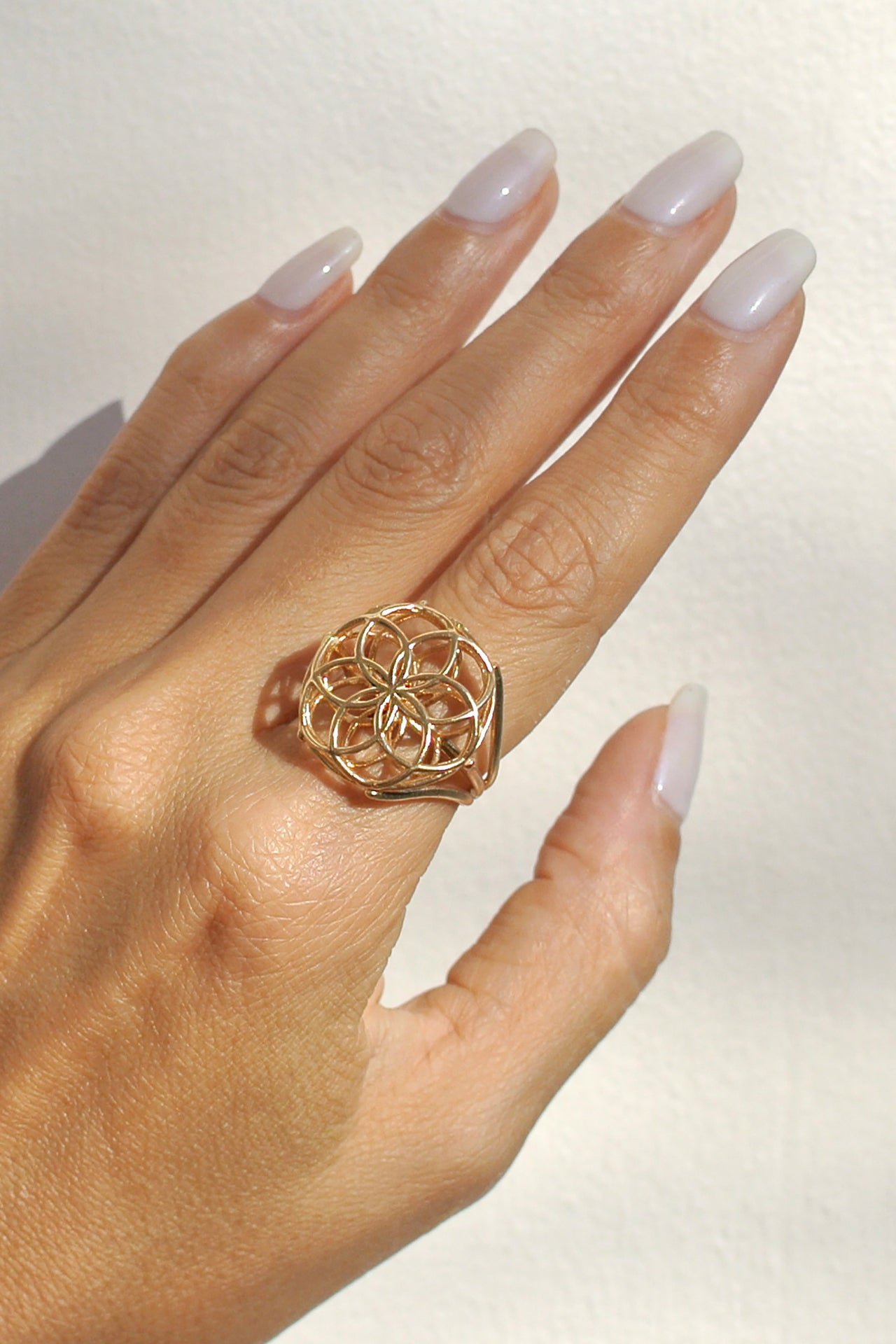 Seed of life ring gold hand