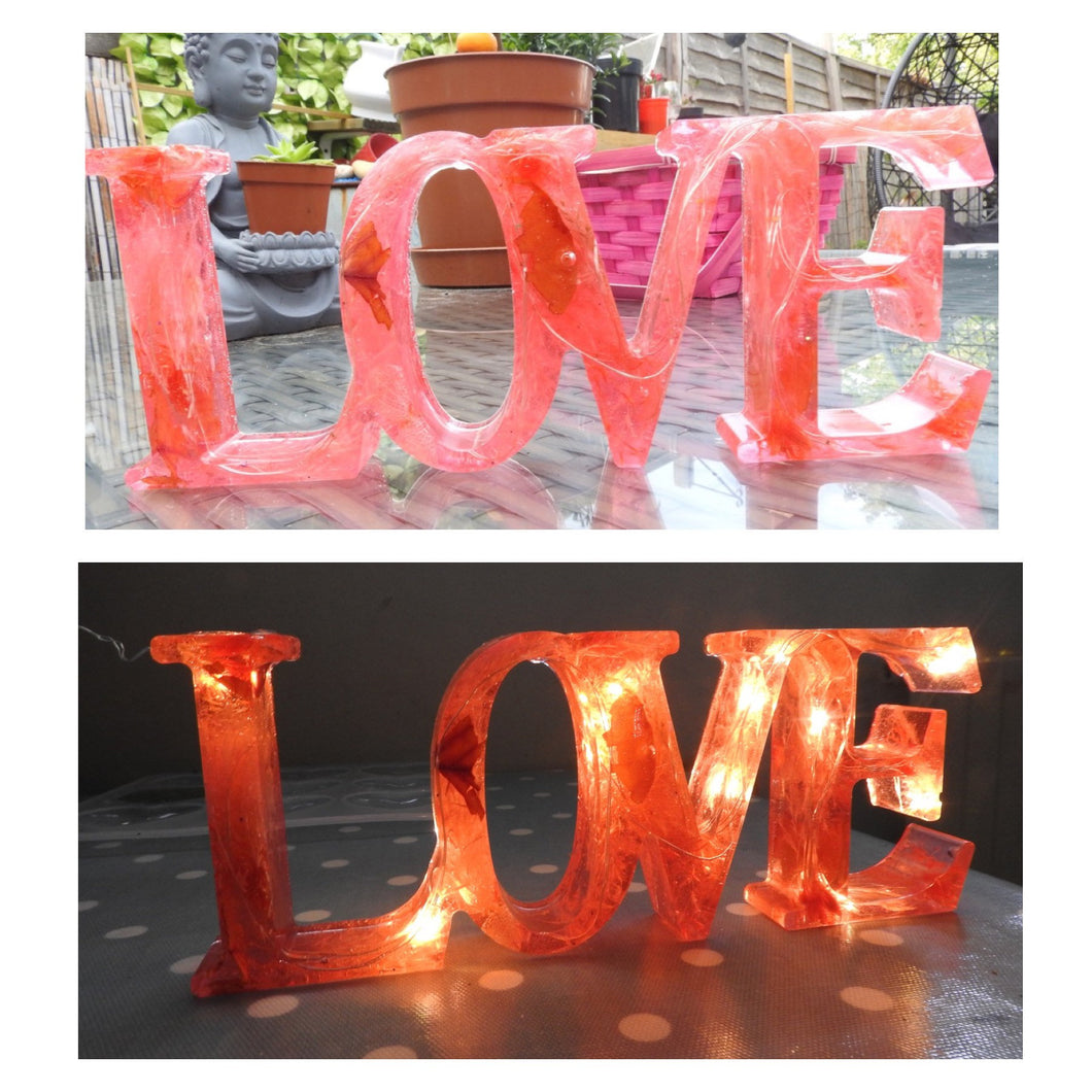 Resin LOVE sign - encased with lights and flowers