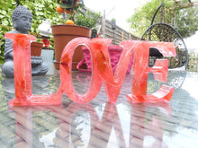 Load image into Gallery viewer, Resin LOVE sign - encased with lights and flowers