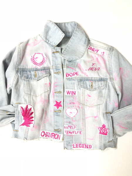 Light blue Jean-ius  jacket with pink lettering
