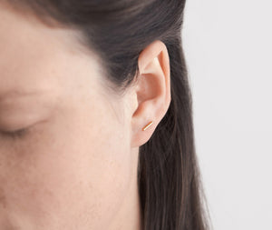 A single bar sterling silver line stud earring