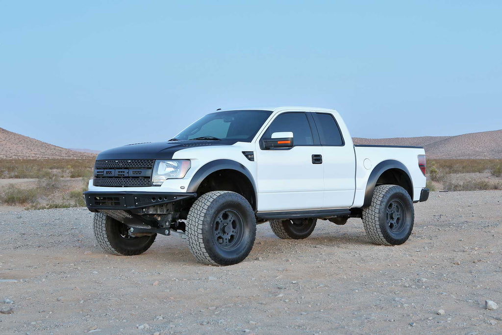 Fabtech 10-14 Ford Raptor 4WD 4in UCA System w/DL 3.0 Resi Coilovers & Rear DL 3.0 Bypass Shocks