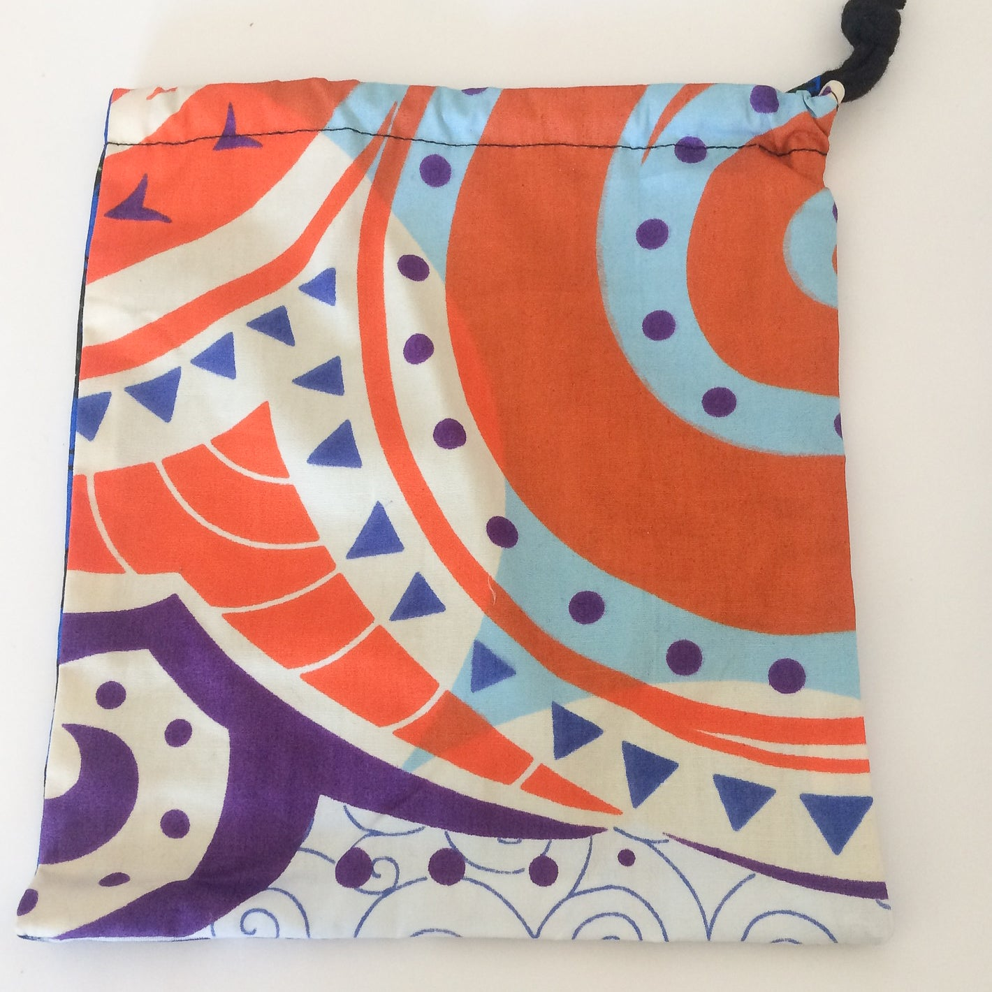 Drawstring bag - Blue swirls / purple & orange spirals, large