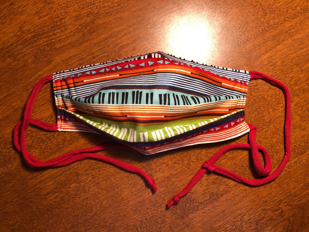 Mask by Laurie Charlton, milti-color piano