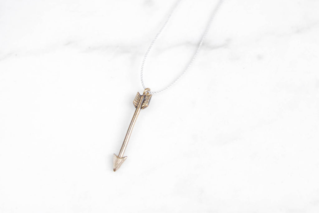 Arrow pendant - silver on grey silk