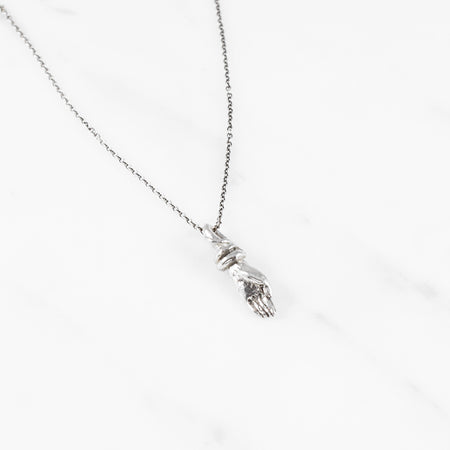 Bound hand necklace - silver