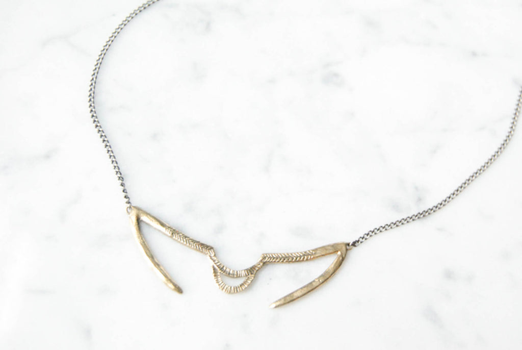 Arch & Needles necklace - brass on silver