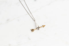 Hand with golden arrow necklace - silver