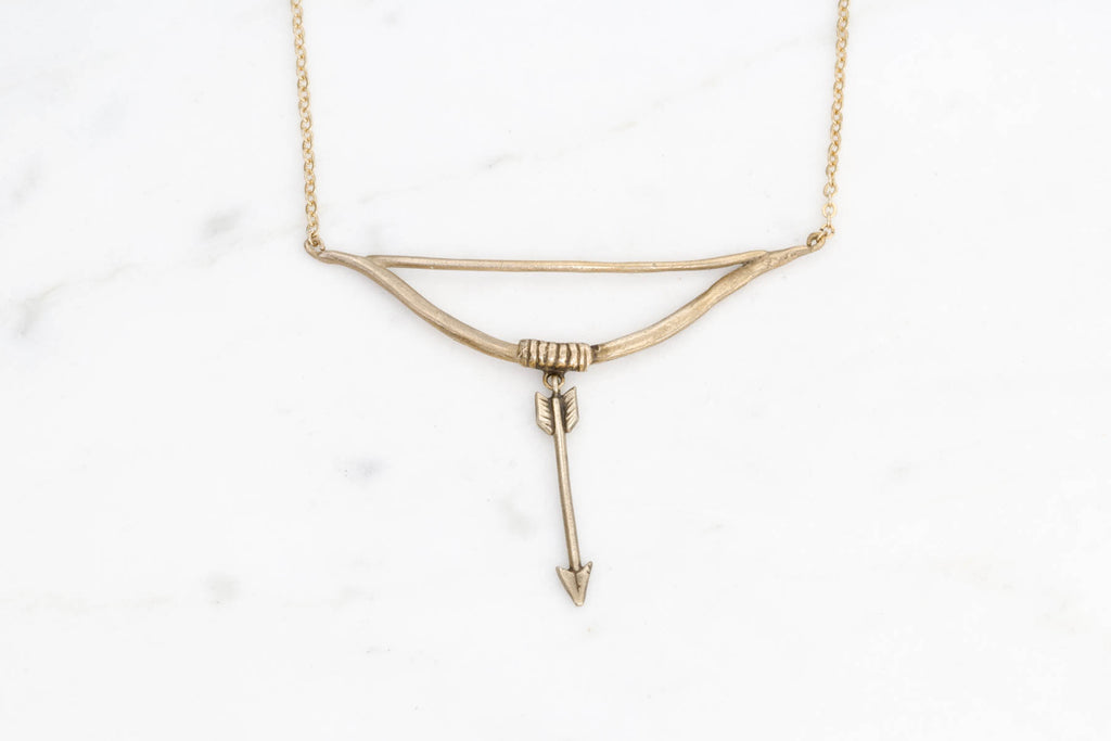 Bow and arrow necklace - brass