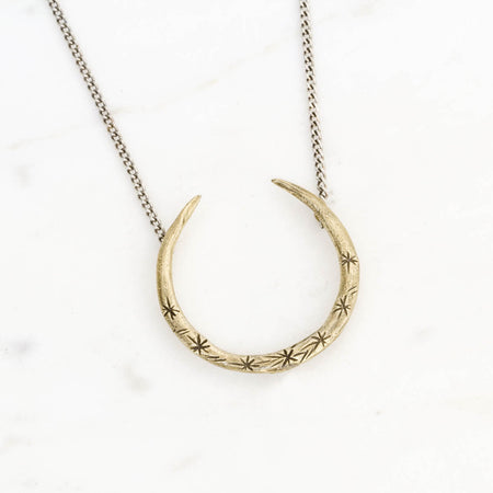 Upturned crescent necklace - brass on silver