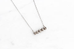 Tiny skulls necklace - silver
