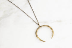 Crescent pendant - brass on silver