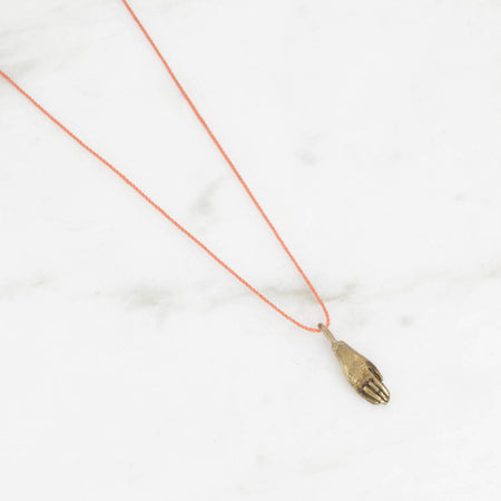 Tiny hand - brass on coral silk