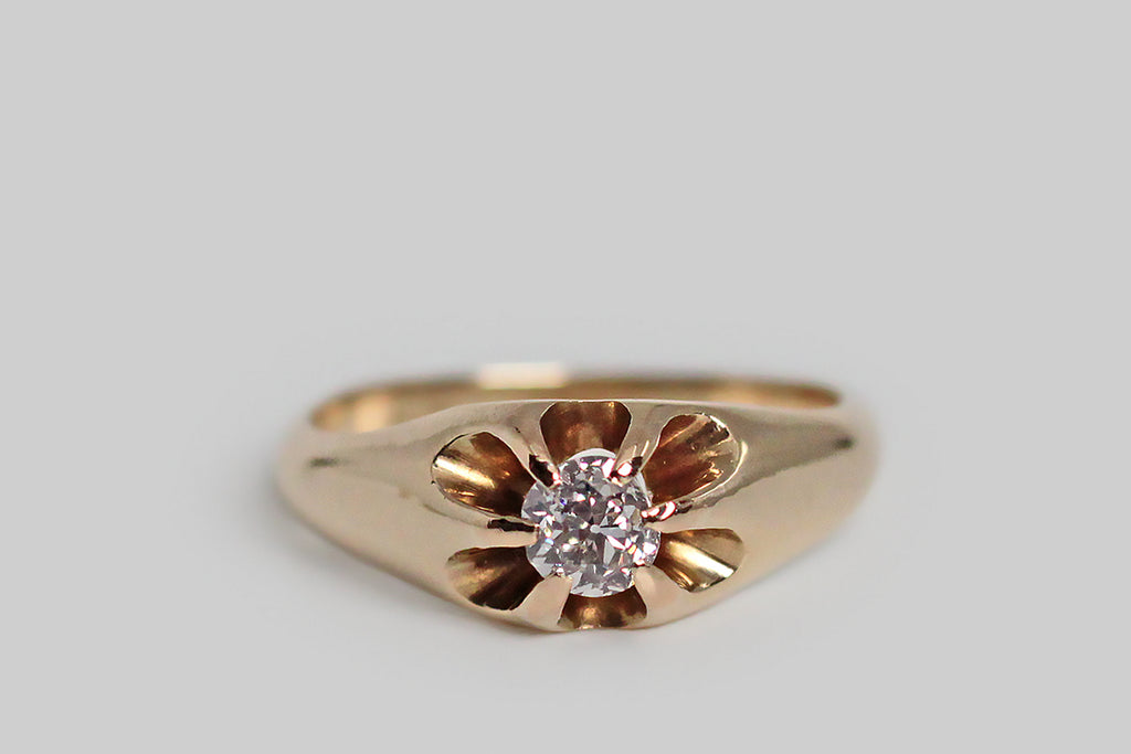 A charming, Victorian-era, Belcher claw ring, modeled in 14k yellow gold, whose six, tapering prongs hold a glittering, .30 carat, old mine cut diamond. The belcher setting is a simple, elegant style, named for its creator, Thomas Belcher— this one is especially graceful, with long, rounded, cutaway sections that give the ring face a floral appearance and create an abundance of light behind its diamond.